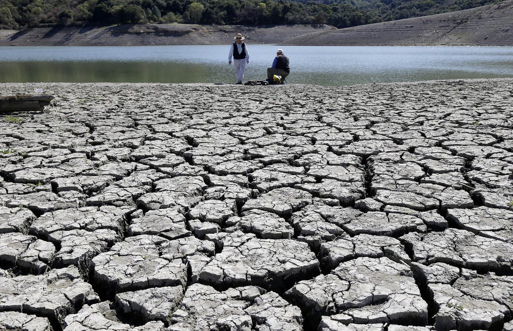 """. <p><b> The Obama administration issued a dire report on Tuesday claiming the nation is facing an unprecedented crisis caused by � </b> <p> A. Global warming <p> B. Climate change <p> C. George W. Bush <p><b><a href=\'http://www.twincities.com/business/ci_25705787/federal-report-warming-disrupts-americans-lives\' target=\""""_blank\""""> LINK </a></b> <p>     (AP Photo/Marcio Jose Sanchez)"""