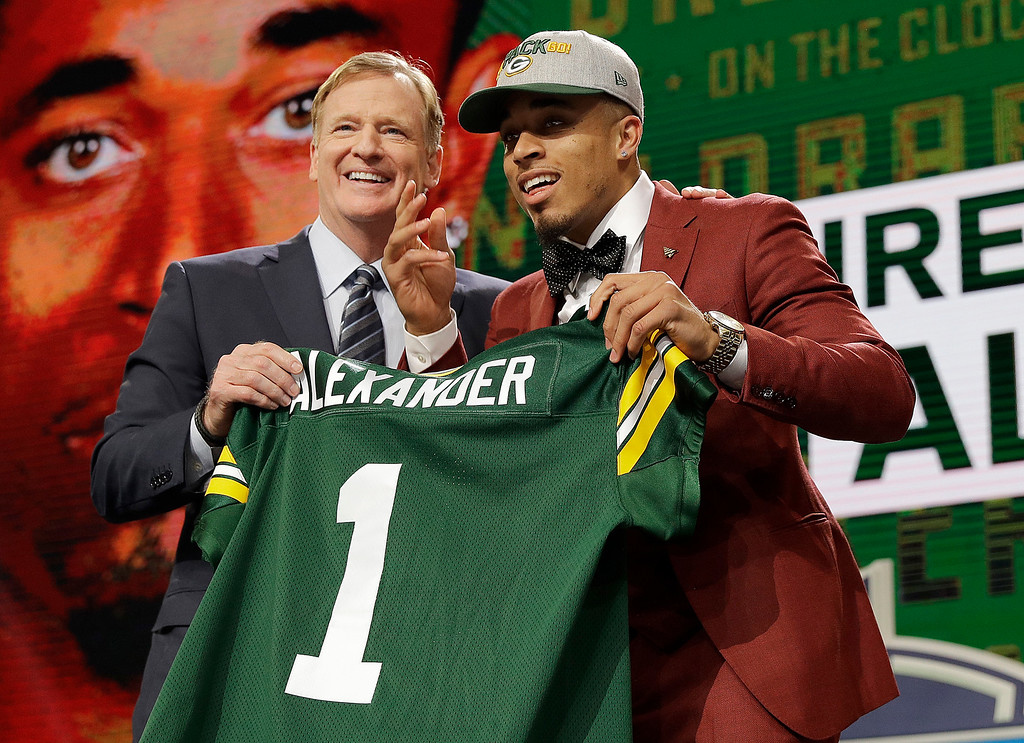 . Commissioner Roger Goodell, left, presents Louisville\'s Jaire Alexander with his Green Bay Packers jersey during the first round of the NFL football draft, Thursday, April 26, 2018, in Arlington, Texas. (AP Photo/David J. Phillip)