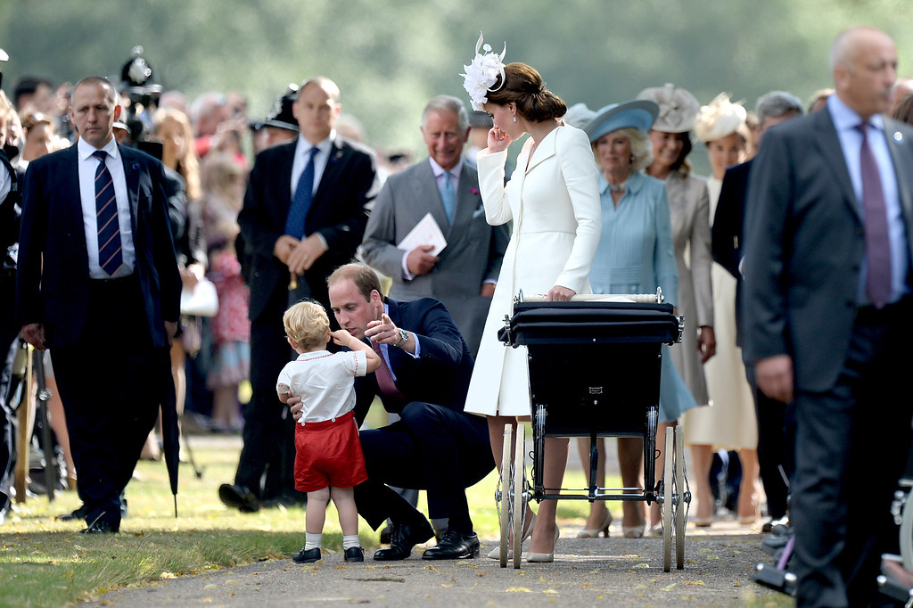 . Prince Charles, Prince of Wales, Camilla, Duchess of Cornwall and Carole Middleto walk behind Catherine, Duchess of Cambridge, Prince William, Duke of Cambridge, Princess Charlotte of Cambridge and Prince George of Cambridge leaving the Church of St Mary Magdalene on the Sandringham Estate after the Christening of Princess Charlotte of Cambridge on July 5, 2015 in King\'s Lynn, England.  (Photo by Mary Turner - WPA Pool/Getty Images)