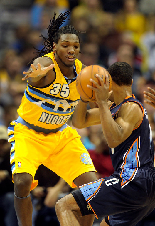 . Denver forward Kenneth Faried (35) covered Bobcats guard Ramon Sessions (7) in the second quarter. The Denver Nuggets hosted the Charlotte Bobcats at the Pepsi Center Saturday night, December 22, 2012.  Karl Gehring/The Denver Post