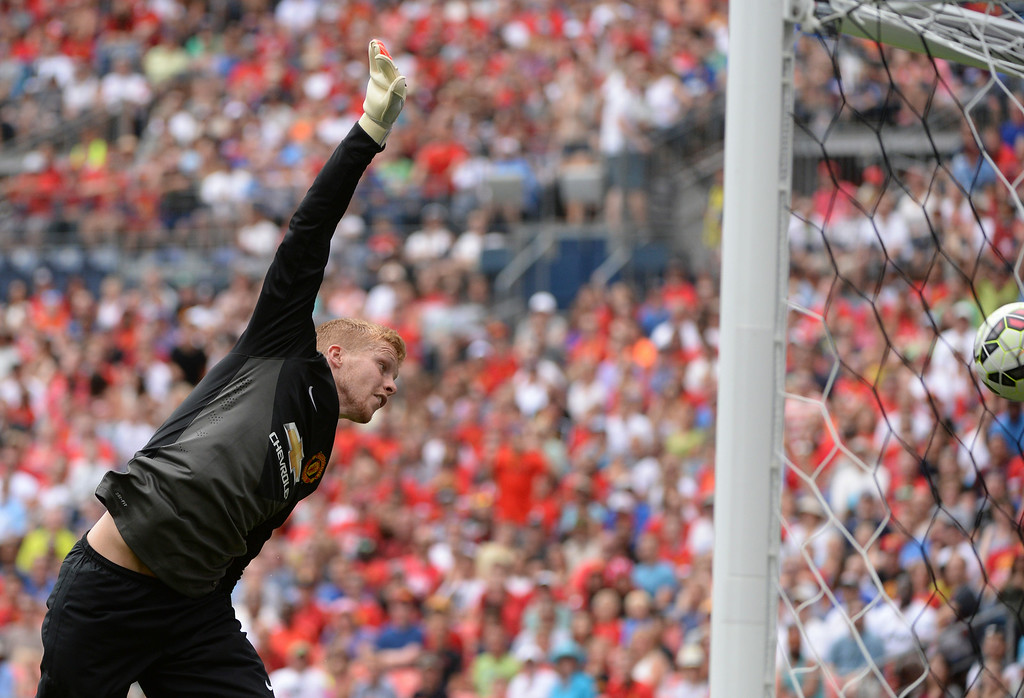 . Manchester United goalie Ben Amos had a shot bounce over his head into the net in the second half. Manchester United defeated AS Roma 3-2 in an exhibition soccer game at Sports Authority Field in Denver Saturday afternoon, July 27, 2014. Photo by Karl Gehring/The Denver Post