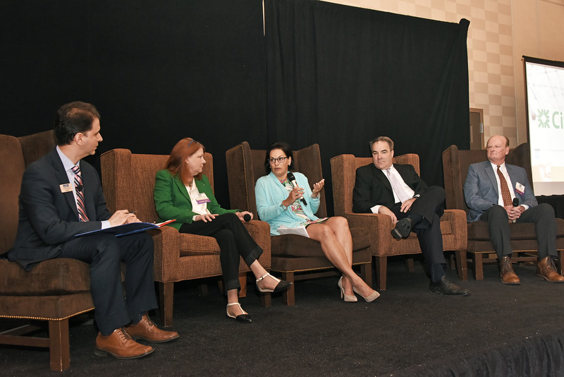 Moderator and senior reporter Michael DeMasi, left, with panelists Susan Novotny, owner of The Book House and The Little Book House of Stuyvesant Plaza and Market Block Books; Ann MacAffer, associate broker with CBRE-Albany; Ted Potrikus, president & CEO at the Retail Council of New York State; and Steve Powers, vice president at Nigro Cos.