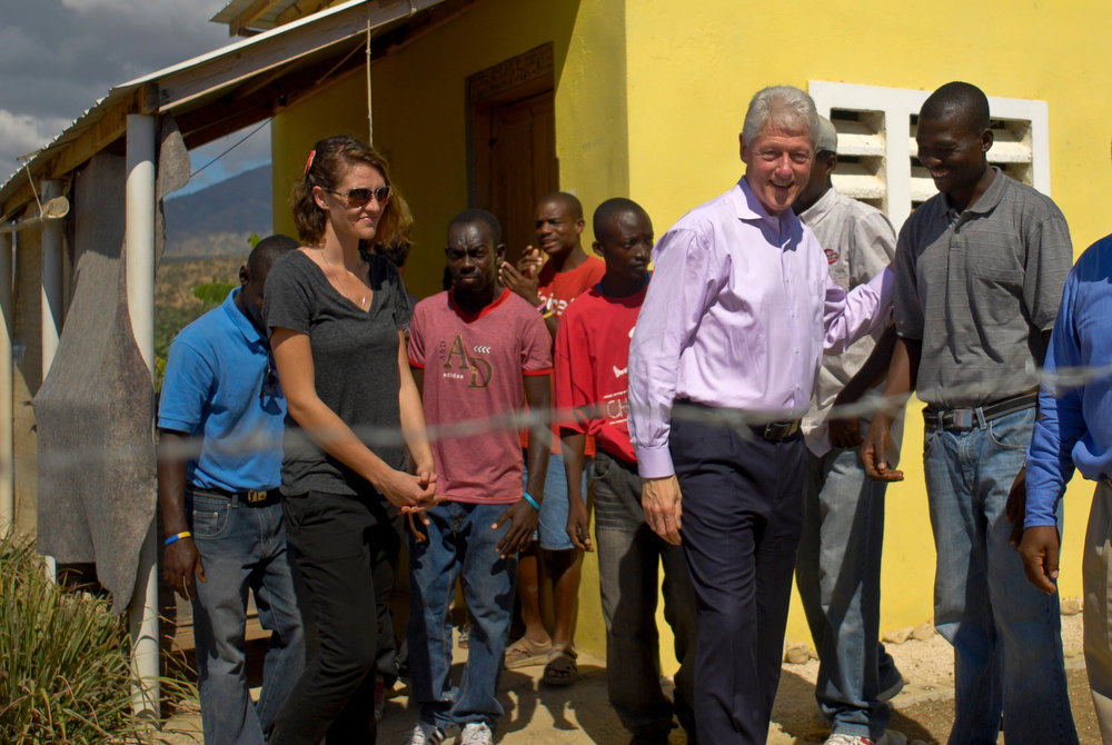 Description of . Former U.S. president Bill Clinton (2nd R) visits the Mission of Hope Leveque Housing Community and Agricultural and Technical Research Training Center in Leveque January 12, 2013. Clinton flew to Haiti on Saturday to join the country\'s president, Michel Martelly, at an official commemoration of the third anniversary of the earthquake that decimated the capital and killed more than 250,000 people. REUTERS/Swoan Parker
