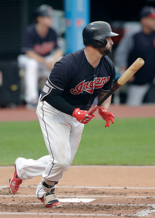 . Cleveland Indians\' Yonder Alonso watches his RBI-single off Minnesota Twins starting pitcher Kohl Stewart during the first inning of a baseball game Wednesday, Aug. 29, 2018, in Cleveland. (AP Photo/Tony Dejak)