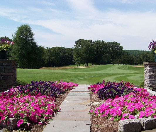 From clubhouse patio overlooking greens in July