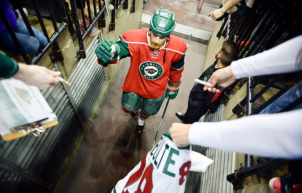 . Minnesota Wild center Kyle Brodziak greets fans after being named one of the players of the game. (Pioneer Press: Ben Garvin)