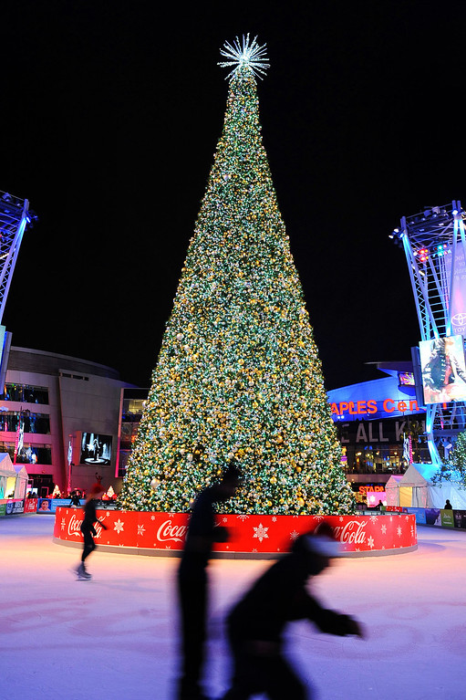 . The sixth annual holiday tree lighting at L.A. LIVE was held Monday, December 2, 2013 in Los Angeles, CA.  The 66-foot tree sits in the center of the LA Kings Holiday Ice Rink -- the largest outdoor ice rink in L.A.   The rink is open daily through December 31, 2013.(Photo by Andy Holzman/Los Angeles Daily News)