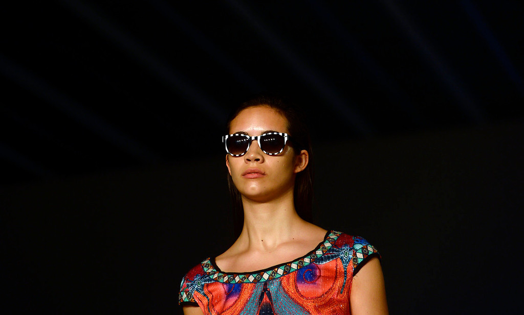 . A model wears a creation from Custo Barcelona during a 080 Barcelona fashion show in Barcelona, Spain, Wednesday, July 10, 2013.  (AP Photo/Manu Fernandez)