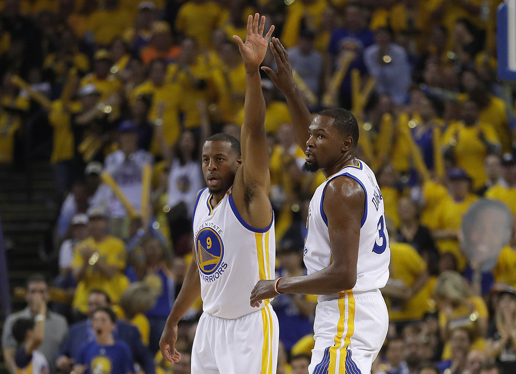 . Golden State Warriors forward Andre Iguodala (9) and forward Kevin Durant (35) react after scoring against the Cleveland Cavaliers during the first half of Game 1 of basketball\'s NBA Finals in Oakland, Calif., Thursday, June 1, 2017. (AP Photo/Marcio Jose Sanchez)