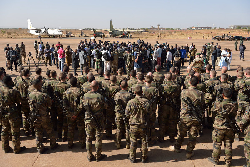 ". French troops based at the 101 airbase near Bamako and journalists listen to Malian president Dioncounda Traore as he makes a welcome speech to the French troops on January 16, 2013. France has deployed 700 troops in and around Paris, Interior Minister Manuel Valls revealed Tuesday in the latest indicator of mounting concern over potential reprisals for military intervention in Mali. Leaders of the militant Islamist groups under attack in the West African state have warned that France has ""opened the doors of hell\"" by unleashing its warplanes and have called on fellow extremists to hit back on French soil. ERIC FEFERBERG/AFP/Getty Images"