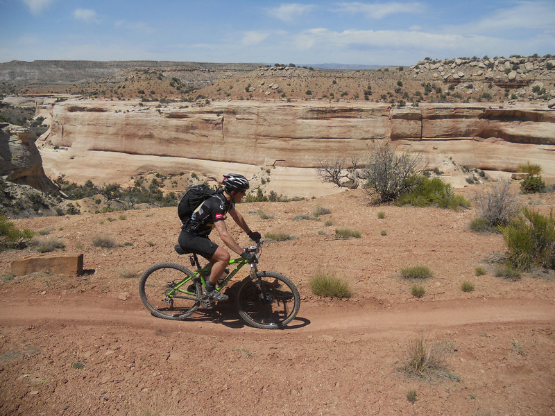 . Claude Pumilia pedals by on Kokopelli\'s Trail. Handout Photo