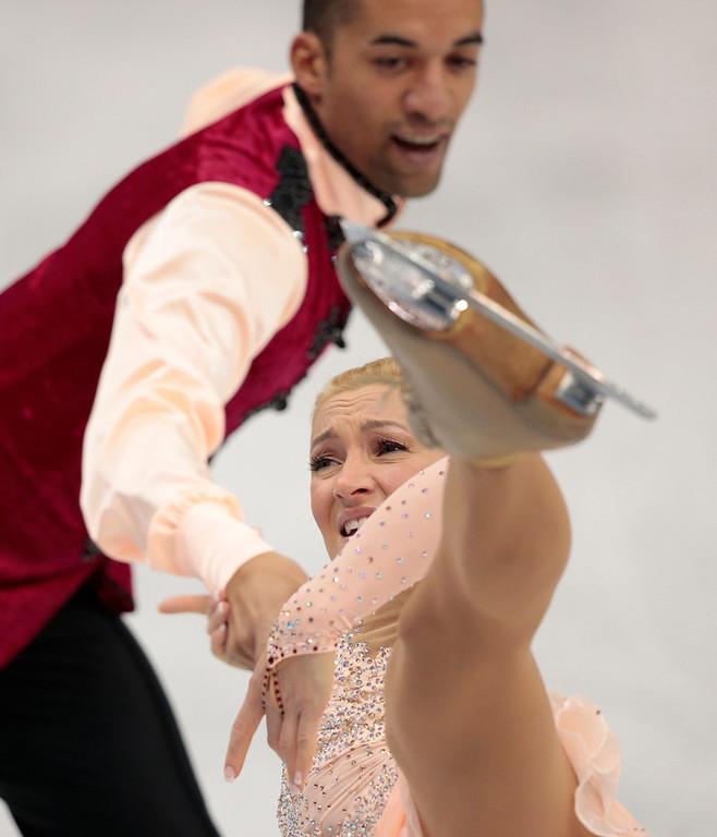 . Aliona Savchenko and Robin Szolkowy of Germany compete in the pairs free skate figure skating competition at the Iceberg Skating Palace during the 2014 Winter Olympics, Wednesday, Feb. 12, 2014, in Sochi, Russia. (AP Photo/Ivan Sekretarev)