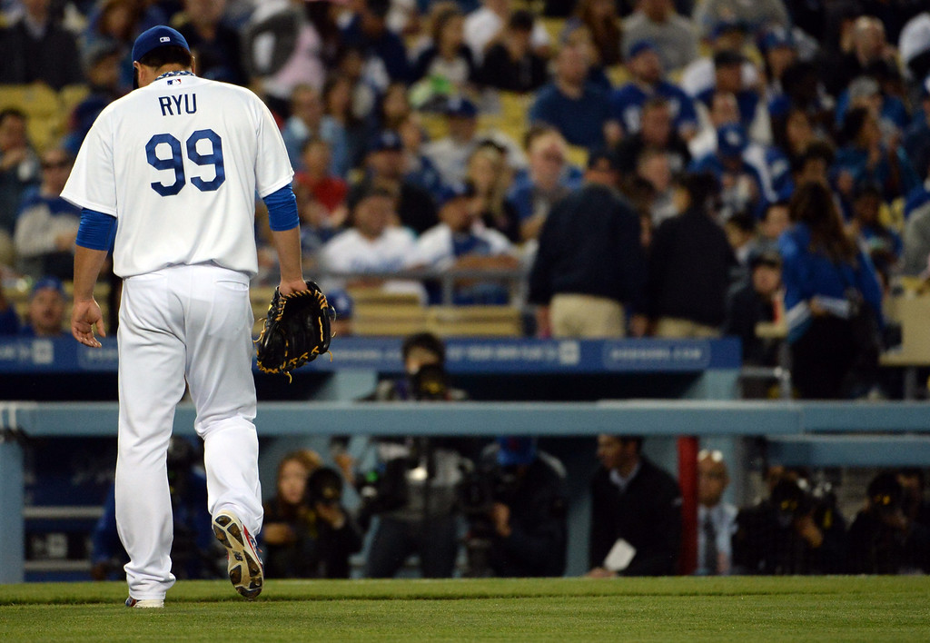 . Los Angeles Dodgers starting pitcher Hyun-Jin Ryu walks-off the field after the second inning of a baseball game against the Philadelphia Phillies on Tuesday, April 22, 2013 in Los Angeles.  (Keith Birmingham/Pasadena Star-News)