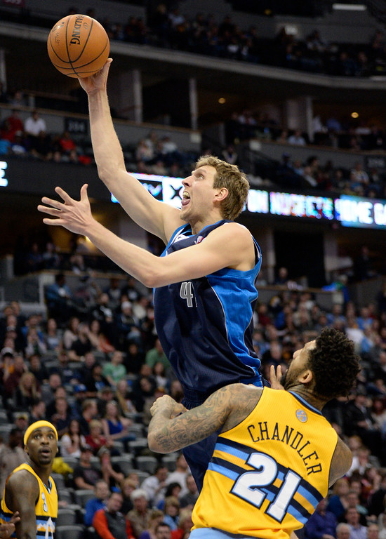 . Dallas Mavericks power forward Dirk Nowitzki (41) takes a shot past Denver Nuggets small forward Wilson Chandler (21) March 5, 2014 at Pepsi Center. The Denver Nuggets defeated the Dallas Mavericks 115-110. (Photo by John Leyba/The Denver Post)