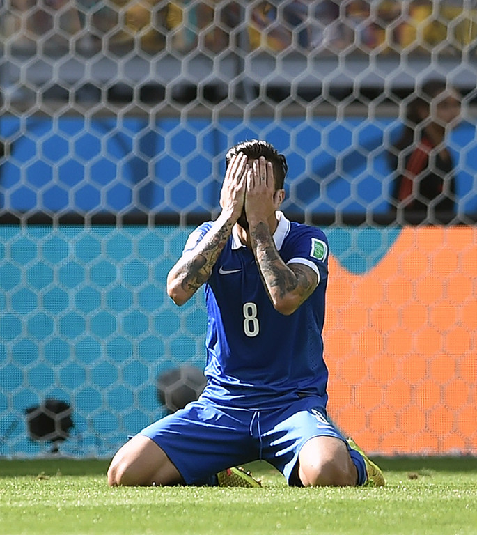 . Greece\'s midfielder Panagiotis Kone gestures after a missed chance on goal during a group C football match between Colombia and Greece at the Mineirao Arena in Belo Horizonte during the 2014 FIFA World Cup on June 14, 2014.  AFP PHOTO / ARIS MESSINIS