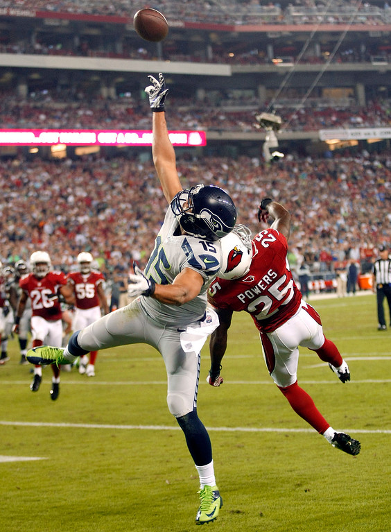 . Seattle Seahawks wide receiver Jermaine Kearse (15) can\'t make the catch as Arizona Cardinals cornerback Jerraud Powers (25) defends during the second half of an NFL football game, Thursday, Oct. 17, 2013, in Glendale, Ariz. (AP Photo/Rick Scuteri)