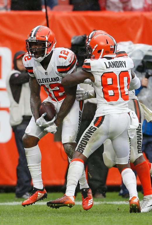. Cleveland Browns wide receiver Josh Gordon (12) reacts after catching a 17-yard touchdown pass during the second half of an NFL football game against the Pittsburgh Steelers, Sunday, Sept. 9, 2018, in Cleveland. (AP Photo/David Richard)