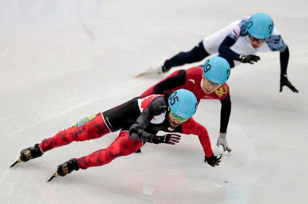 . Charles Hamelin of Canada leads in a men\'s 1500m short track speedskating final at the Iceberg Skating Palace during the 2014 Winter Olympics, Monday, Feb. 10, 2014, in Sochi, Russia. (AP Photo/Ivan Sekretarev)