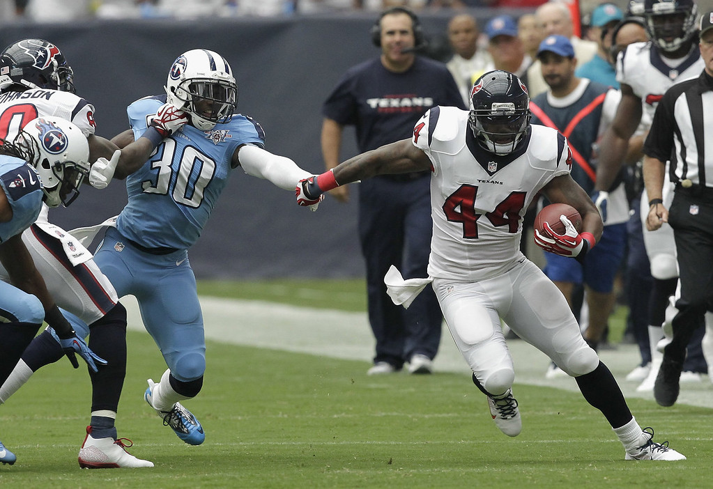 . Ben Tate #44 of the Houston Texans turns the corner on Jason McCourty #30 of the Tennessee Titans as he breaks loose for a large run in the first quarter at Reliant Stadium on September 15, 2013 in Houston, Texas. (Photo by Bob Levey/Getty Images)