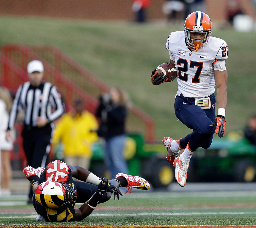 . Syracuse running back George Morris II (27) leaps past Maryland linebacker Yannick Ngakoue as he rushes the ball in the first half of an NCAA college football game in College Park, Md., Saturday, Nov. 9, 2013. (AP Photo/Patrick Semansky)