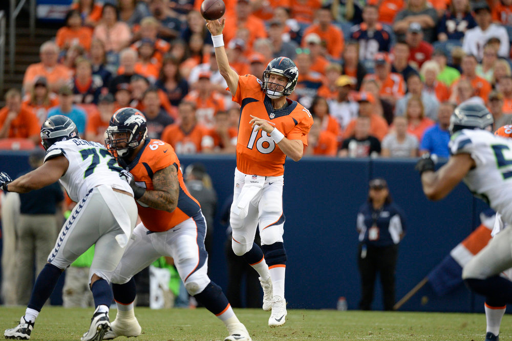. Quarterback Peyton Manning (18) of the Denver Broncos throws a pass in the first quarto against the Seattle Seahawks August 7, 2014 at Sports Authority Field at Mile High Stadium.  (Photo by John Leyba/The Denver Post)