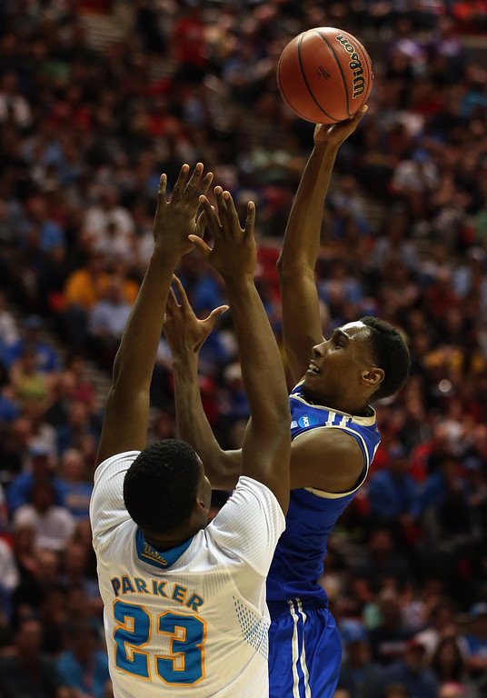 . Rashad Smith #1 of the Tulsa Golden Hurricane takes a shot over Tony Parker #23 of the UCLA Bruins during the second round of the 2014 NCAA Men\'s Basketball Tournament at Viejas Arena on March 21, 2014 in San Diego, California.  (Photo by Jeff Gross/Getty Images)