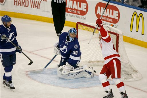 . The puck bounces in the net behind Tampa Bay Lightning goalie Ben Bishop (30) as Detroit Red Wings left wing Henrik Zetterberg (40), right, celebrates Detroit\'s first-period goal during Game 1 of an NHL hockey first-round playoff series, Thursday, April 16, 2015, in Tampa, Fla. (Douglas R. Clifford/Tampa Bay Times via AP)