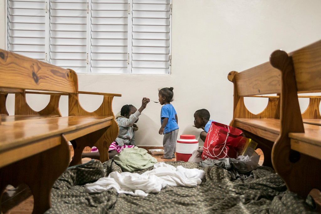 . Kids have dinner at a shelter in a local church during the evening before the arrival of Hurricane Irma in Las Terrenas, Dominican Republic, Wednesday, Sept. 6, 2017. Dominicans wait for the arrival of Hurricane Irma after it lashed Puerto Rico with heavy rain and powerful winds, leaving nearly 900,000 people without power as authorities struggled to get aid to small Caribbean islands already devastated by the historic storm. (AP Photo/Tatiana Fernandez)