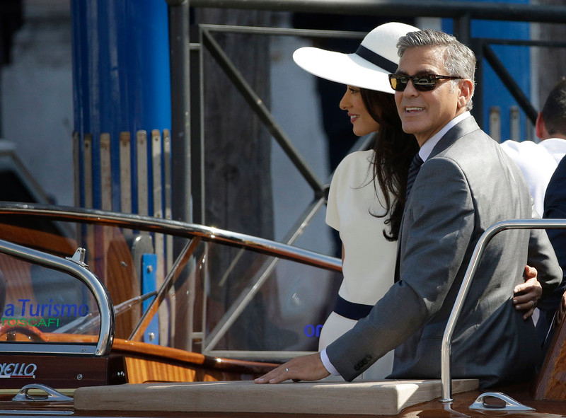 . George Clooney and Amal Alamuddin leave Venice\'s city hall, Italy, Monday, Sept. 29, 2014. Clooney and Amal married Saturday, Sept. 27, the actor\'s representative said, out of sight of pursuing paparazzi and adoring crowds.(AP Photo/Andrew Medichini)