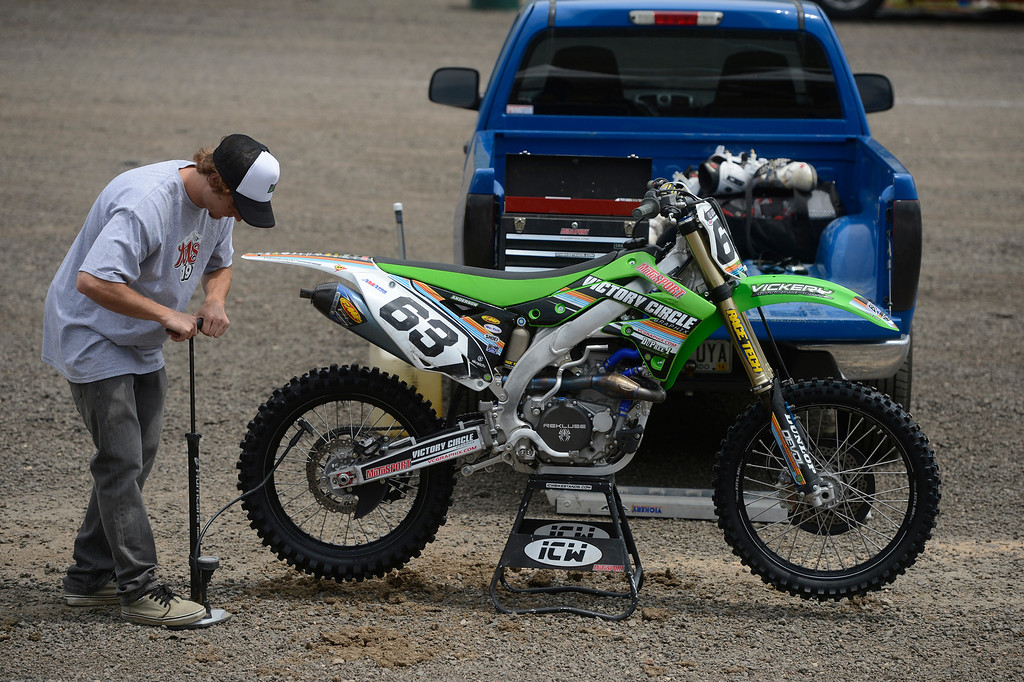 . LAKEWOOD, CO - MAY 23:  Local professional motocross rider, Derek Anderson, from Arvada Colorado, pumps up the back tire of his 450cc motocross bike in preparation for a practice run on media day at the AMA Thunder Valley National at the Thunder Valley Motocross Park in Lakewood Colorado, Thursday May 23, 2013. The main AMA event is this Saturday at Thunder Valley. (Photo By Andy Cross/The Denver Post)