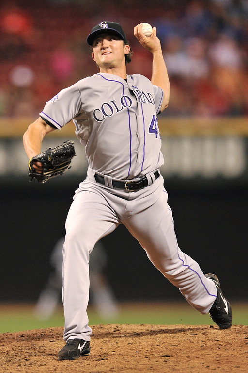 . Rex Brothers #49 of the Colorado Rockies pitches in the ninth inning against the Cincinnati Reds at Great American Ball Park on June 4, 2013 in Cincinnati, Ohio. Brothers earned the save as Colorado defeated Cincinnati 5-4.  (Photo by Jamie Sabau/Getty Images)