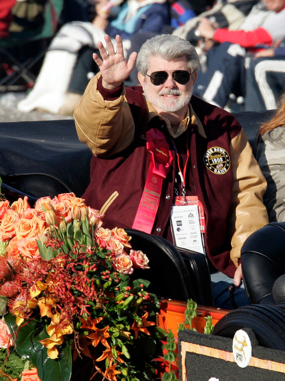". Grand Marshal George Lucas, creator of the ""Star Wars\"" saga, rides down Colorado Boulevard in the 118th Rose Parade in Pasadena, Calif., Monday, Jan. 1, 2007. (AP Photo/Reed Saxon)"