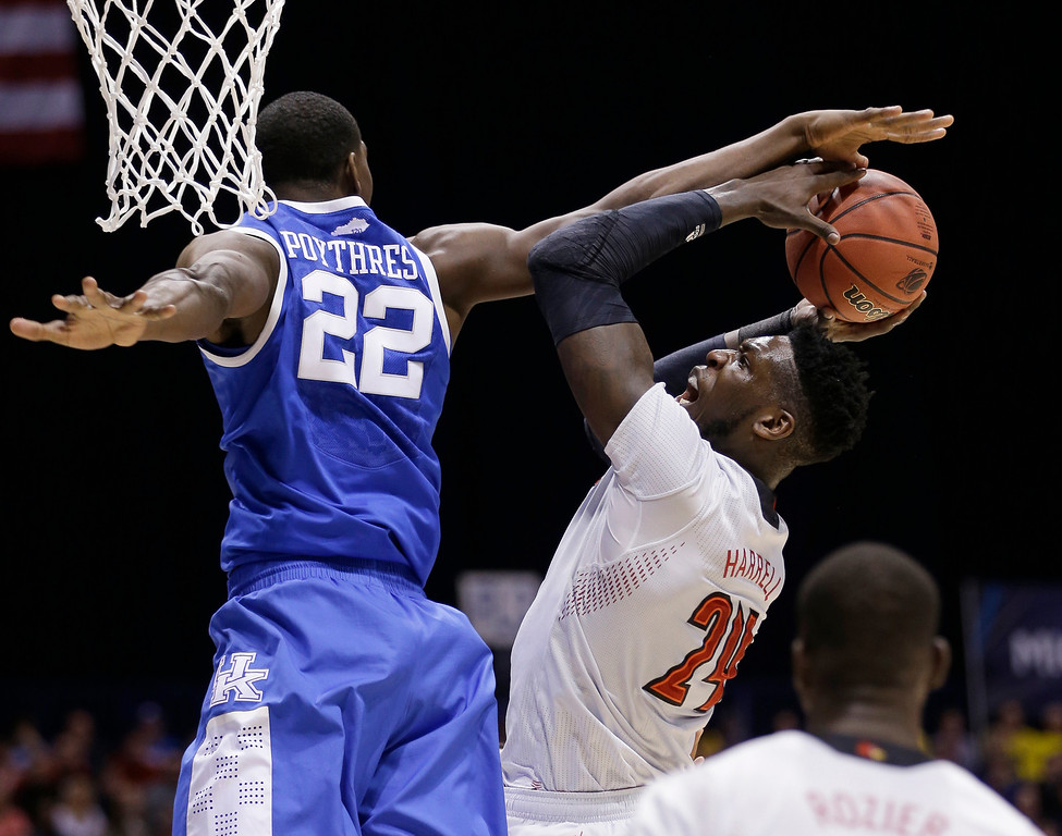 . Kentucky\'s Alex Poythress (22) blocks a shot of Louisville\'s Montrezl Harrell (24) during the first half of an NCAA Midwest Regional semifinal college basketball tournament game Friday, March 28, 2014, in Indianapolis. (AP Photo/David J. Phillip)
