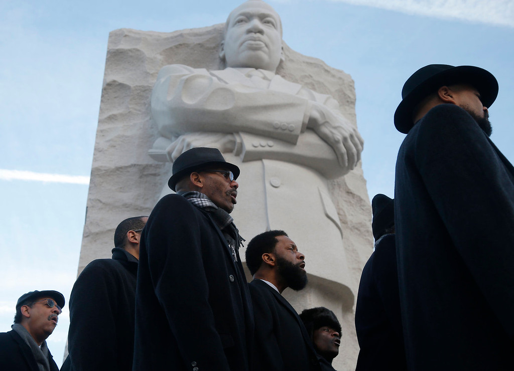 . The men\'s choir from the People\'s Community Baptist Church in Silver Spring, Md., sing at the Martin Luther King Jr. Memorial in Washington, Monday, Jan. 20, 2014. The nation paused to remember Martin Luther King Jr. Monday with parades, marches and service projects.  King was born Jan. 15, 1929, and the federal holiday is the third Monday in January. (AP Photo/Charles Dharapak)