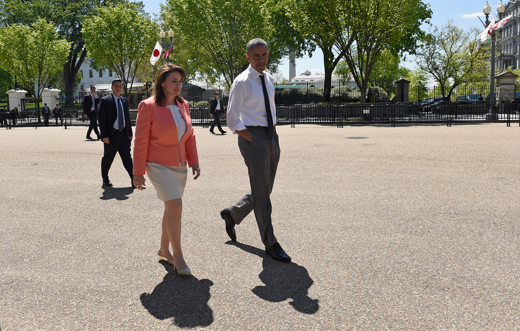 . President Barack Obama takes a walk along Pennsylvania Avenue in Washington, Wednesday, April 29, 2015, with 2015 National Teacher of the Year Shanna Peeples of Amarillo, Texas, following an event to honor the 2015 National Teacher of the Year and finalists in the Rose Garden. (AP Photo/Susan Walsh)