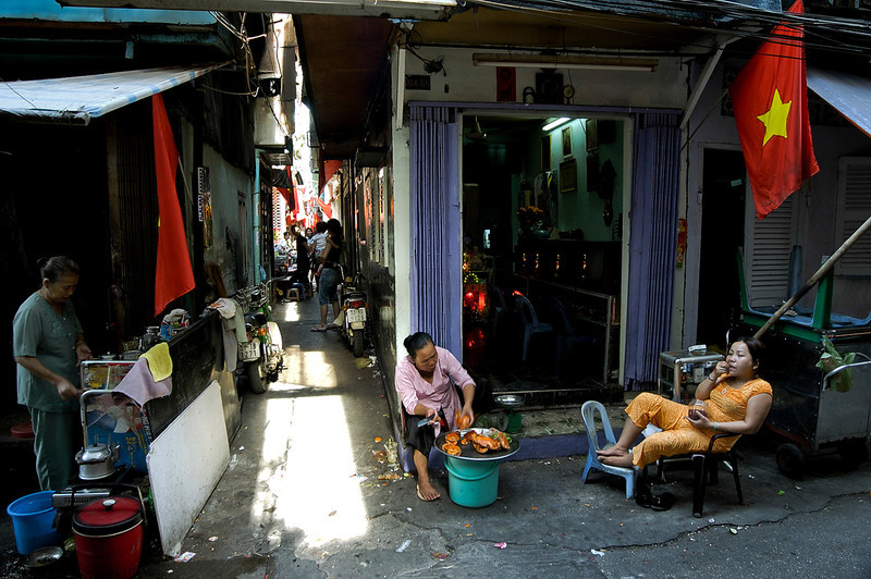 street vendors wait for clients outside an internet cafe in the back streets of Saigon.