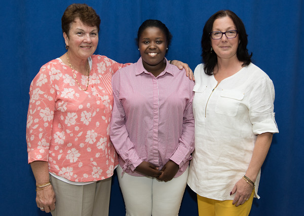 05/24/18 Wesley Bunnell | Staff New Britain High School held their Senior Scholarship Night at the high school on Thursday night. Tatianna Lockhart received the Judy Keenan Greco Scholarship from Helen B. Cieslowski, L, and Sharon Beloin-Saavedra, R. Lockhart will study Early Childhood Education at UMASS Boston.