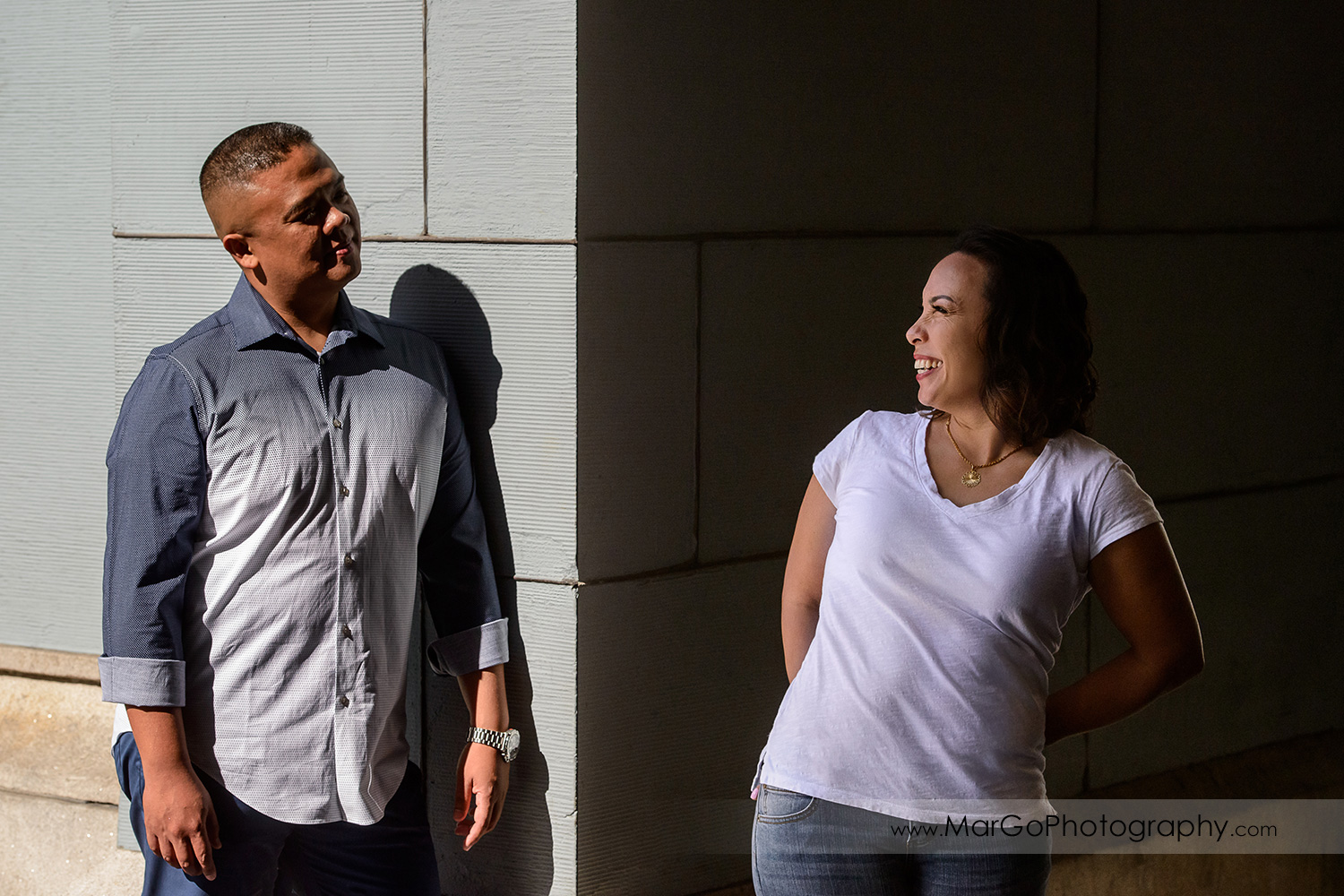 engagement session at Ferry Building in San Francisco - he in sun and she in shade