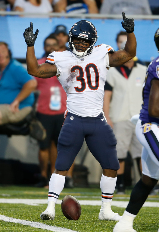 . Chicago Bears running back Benny Cunningham (30) celebrates a first down against the Baltimore Ravens in the first half at the Pro Football Hall of Fame NFL preseason game, Thursday, Aug. 2, 2018, in Canton, Ohio. (AP Photo/Ron Schwane)