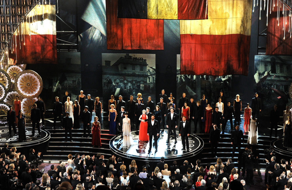 Description of . Hugh Jackman and the cast of Les Miserables perform onstage during the Oscars held at the Dolby Theatre on February 24, 2013 in Hollywood, California.  (Photo by Kevin Winter/Getty Images)