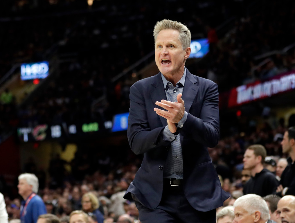 . Golden State Warriors coach Steve Kerr encourages his team during the first half against the Cleveland Cavaliers in Game 3 of basketball\'s NBA Finals, Wednesday, June 6, 2018, in Cleveland. (AP Photo/Tony Dejak)