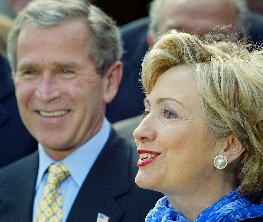 . President Bush jokes with Sen. Hillary Rodham Clinton, D-N.Y., during a ceremony in the Rose Garden with members of the New York congressional delegation, Thursday, March 7, 2002.  (AP Photo/Doug Mills)