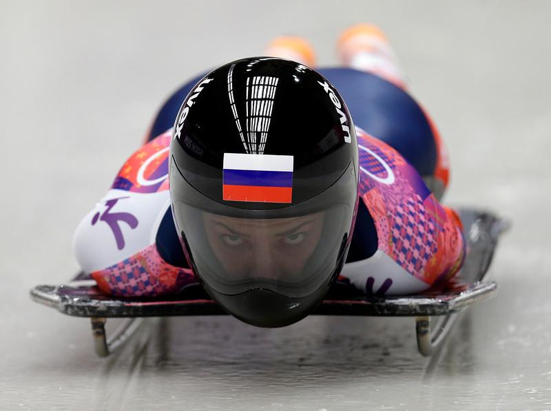 . Elena Nikitina of Russia starts her third run during the women\'s skeleton competition at the 2014 Winter Olympics, Friday, Feb. 14, 2014, in Krasnaya Polyana, Russia. (AP Photo/Natacha Pisarenko)
