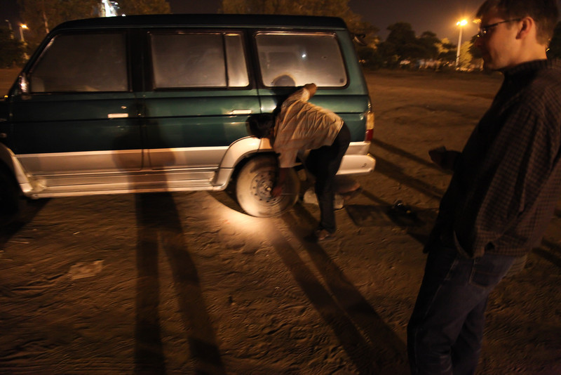 After finally getting out of the airport in Ahmedabad (and being down one bag) we got to the car and had a flat tire.