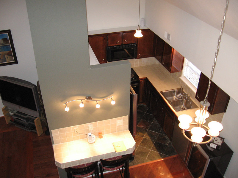 THe breakfast area and kitchen viewed from the loft.