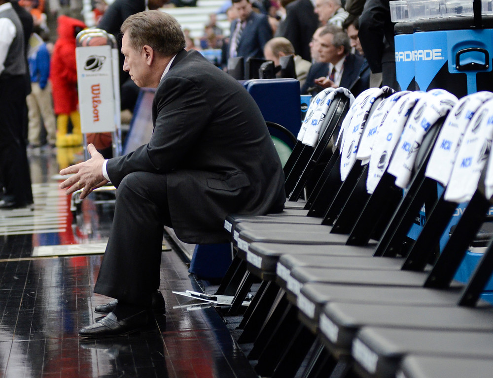 . Michigan State head coach Tom Izzo sits as his team warms up before a regional final against Louisville in the NCAA men\'s college basketball tournament Sunday, March 29, 2015, in Syracuse, N.Y. (AP Photo/Heather Ainsworth)