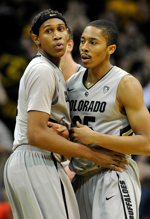 . BOULDER, CO. - FEBRUARY 14: Colorado Buffaloes forward Xavier Johnson (2) and guard Spencer Dinwiddie (25) shined in the win Thursday night. The University of Colorado men\'s basketball team defeated Arizona 71-58 Thursday night, February 14, 2013 at the Coors Event Center in Boulder. (Photo By Karl Gehring/The Denver Post)