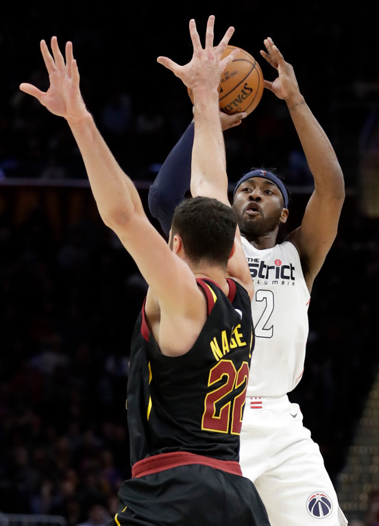 . Washington Wizards\' John Wall (2) shoots over Cleveland Cavaliers\' Larry Nance Jr. (22) in the second half of an NBA basketball game, Thursday, April 5, 2018, in Cleveland. (AP Photo/Tony Dejak)