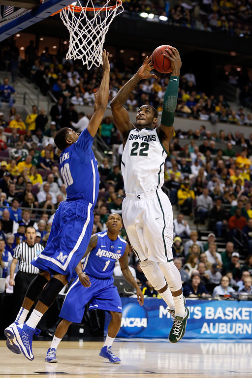 . AUBURN HILLS, MI - MARCH 23:  Branden Dawson #22 of the Michigan State Spartans drives for a shot attempt in the first half against D.J. Stephens #30 of the Memphis Tigers during the third round of the 2013 NCAA Men\'s Basketball Tournament at The Palace of Auburn Hills on March 23, 2013 in Auburn Hills, Michigan.  (Photo by Gregory Shamus/Getty Images)