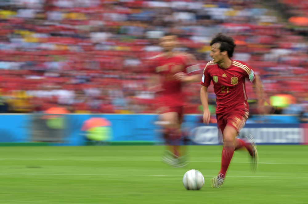 . Spain\'s midfielder David Silva drives the ball during a Group B football match between Spain and Chile in the Maracana Stadium in Rio de Janeiro during the 2014 FIFA World Cup on June 18, 2014. Chile won 2-0.  (GABRIEL BOUYS/AFP/Getty Images)